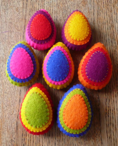 Wool/felt Easter Eggs...because these will provide minutes, er, hours of entertainment.